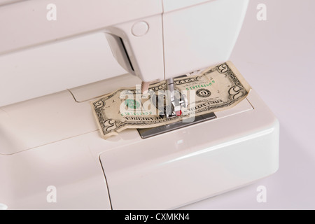 to sew a dollar banknote - Stock Photo