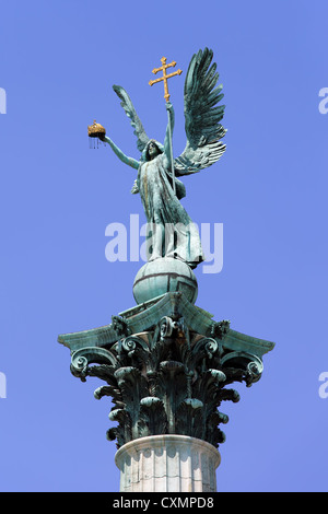 Archangel Gabriel statue holding Holy Crown of St. Stephen and Apostolic Cross, part of the Millennium Monument - Stock Photo