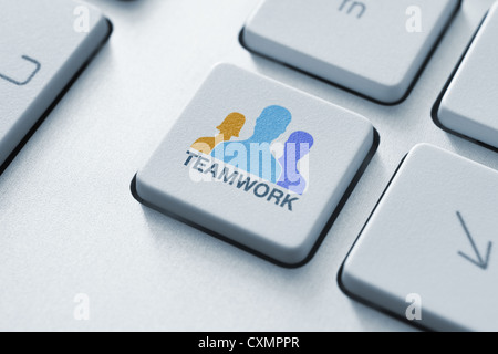 43acb344a44 success in business concept with key on computer keyboard · Teamwork key on keyboard  concept. Toned image. - Stock Photo