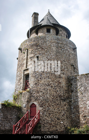 A beautiful stone round tower at one of the corners of Chateau de Fougeres in Brittany, France - Stock Photo