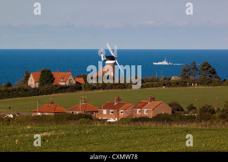 Weybourne Mill taken from Kelling Heath Station platform on the North Norfolk Railway. - Stock Photo