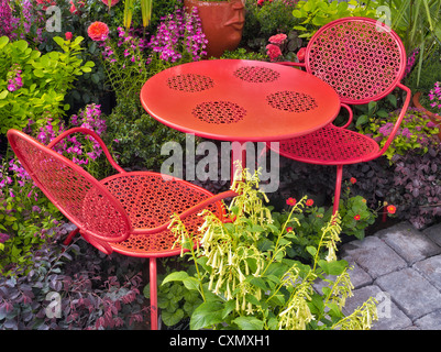 Table and chairs in flower garden display. Al's Nursery. Sherwood, Oregon - Stock Photo