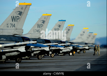 Crew chiefs assigned to the 8th Fighter Wing, Kunsan Air Base, Korea, perform final inspections on F-16 Fighting - Stock Photo