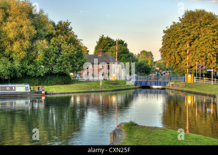 Kennet and Avon Canal between Padworth and Aldermaston in Berkshire showing lifting bridge and narrow boat - Stock Photo