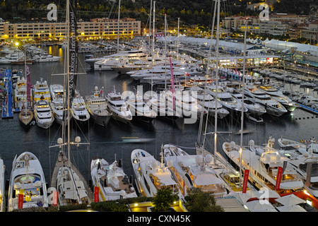 Yachts at the 2012 Monaco Yacht Show at dusk - Stock Photo