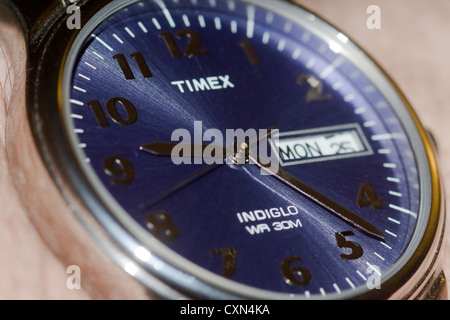 Macro Photograph. Late for Work Concept. Wristwatch on an arm showing Monday at 9:23 a.m. - Stock Photo