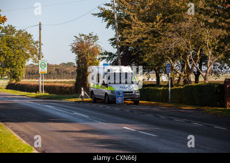 Mobile camera on side of road in village - Stock Photo