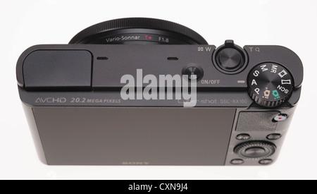 High-end Sony Cyber-shot DSC-RX100 large sensor zoom compact digital camera 20 megapixels. - Stock Photo