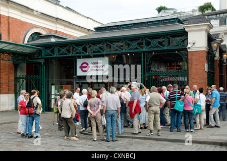 Group of tourist outside the London Transport Museum, Covent Garden, London England Britain UK - Stock Photo