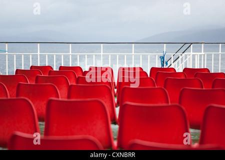 Empty red seats on Caledonian MacBrayne ferry, Scotland. - Stock Photo