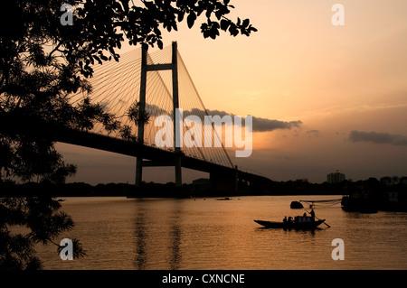 Sun set at Kolkata near Vidyasagar Setu, West Bengal, India - Stock Photo