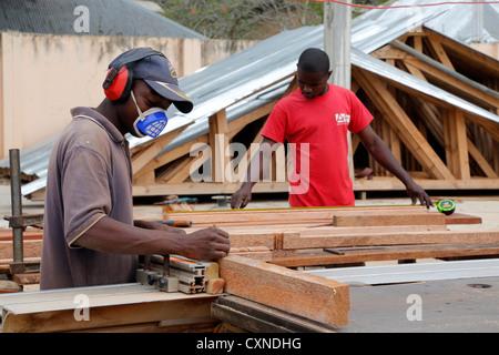 students at a carpenter's workshop, Machui Vocational Center in Machui, Zanzibar, Tanzania - Stock Photo