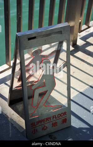 Slippery floor warning sign at the Star Ferry Pier, Hongkong CN - Stock Photo