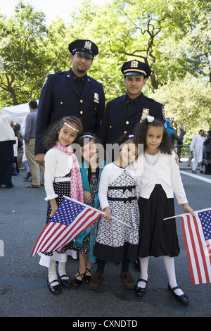 Annual Muslim American Day Parade on Madison Avenue in New York City. NYC police officers with their kids march - Stock Photo