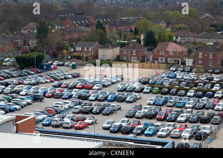 high view of busy full workplace carpark - Stock Photo