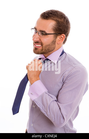Portrait of anxious businessman loosening his necktie. - Stock Photo