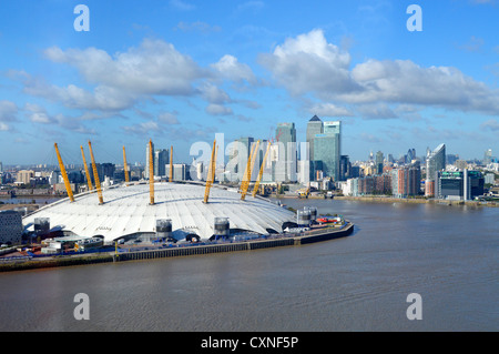 River Thames with O2 dome arena on Greenwich Peninsula and Canary Wharf skyline on the Isle of Dogs - Stock Photo