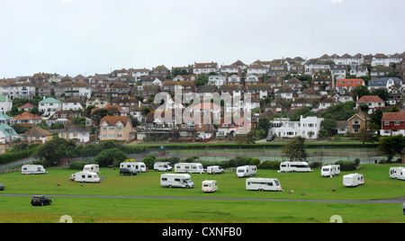 A group of travellers set up an illegal camp in Saltdean park in East Sussex - Stock Photo