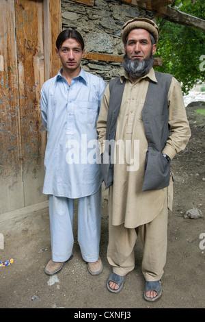 Moyhadin Khan, a Muslim convert with his eldest son who is still a Kalash, village of Kalasha Grum, Rumbur Valley, - Stock Photo