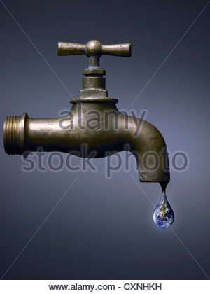 Old tap with world drop, abstract on dark background - Stock Photo
