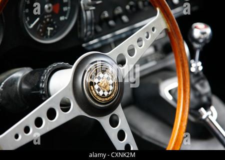 Jaguar E-Type interior shot of steering wheel and dashboard - Stock Photo