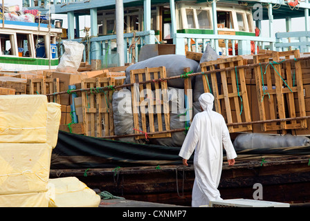 Goods on dock waiting to be loaded onto dhows for transportation, Deira, Dubai, United Arab Emirates, Middle East - Stock Photo