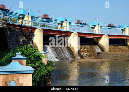 Spillway Water Draining through the Aruvikkara Dam in Karamana river at Kerala - Stock Photo