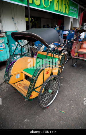 Typical Rickshaw in Yogyakarta in Indonesia - Stock Photo