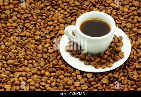 cup with coffee costing on coffee grain stock photo royalty free image 21943914 alamy. Black Bedroom Furniture Sets. Home Design Ideas