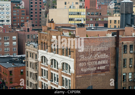 New York, NY - 6 Oct 2012 - Buildings along Sixth Avenue viewed from Jefferson Market Library - Stock Photo