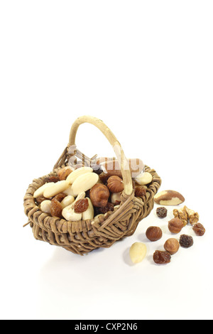 Mixed nuts and raisins as a snack on a light background - Stock Photo