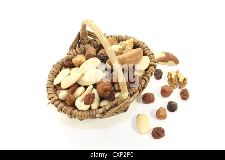 fresh crunchy mixed nuts and raisins as a snack on a light background - Stock Photo