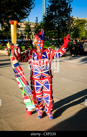 Street performer in a Union Jack flag suit in London - Stock Photo