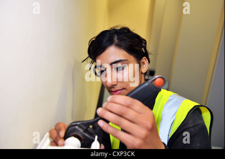 A Young Plumbing Apprentice practices at a training centre in Bradford - Stock Photo