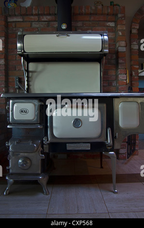 Antique wood stove with hot water spigot and bread keeper - Stock Photo
