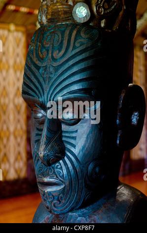 Maori wall carvings in a Marae (meeting house). - Stock Photo