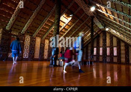 WAITANGI - OCTOBER 02: Visitors at the Maori meeting house (Marae) near the Treaty House on October 02 2012 in Waitangi, - Stock Photo