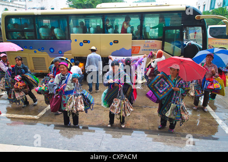 Petty traders offering their goods at the door step of a hotel. - Stock Photo
