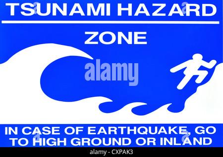 A tsunami warning and hazard sign. - Stock Photo