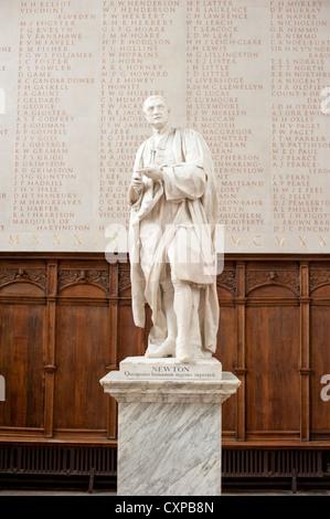 Statue of Isaac Newton in Trinity College, Cambridge, UK - Stock Photo