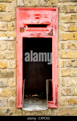 Disused / dis used / abandoned / neglected / vandalised Victorian wall mounted box / letterbox / pillarbox. Homerton, - Stock Photo