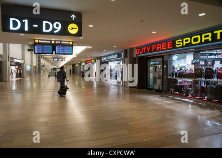 Ben Gurion (TLV) Airport, Israel. Duty-free shops and boarding signs. - Stock Photo
