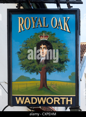 Sign of the Royal Oak pub in Pewsey, after King Charles II who hid in an oak tree to escape the Roundheads during - Stock Photo
