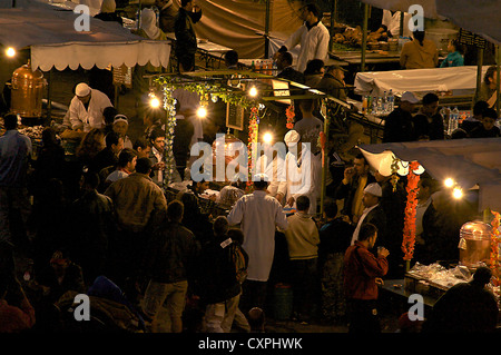 North Africa, Morraco, Marrakech. Night time dining at outdoor restaurants on Jemaa el-Fnaa Square. - Stock Photo