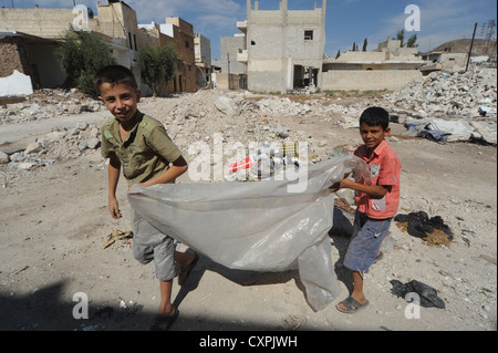 the lives of children who somehow are trying desperately to stay alive and grow up amidst the carnage and mayhem - Stock Photo