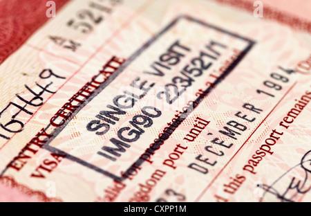 British visa stamp in passport - Stock Photo