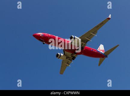 Virgin Australia passenger jet on landing approach - Stock Photo
