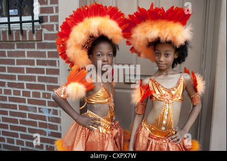 USA: Brooklyn, NY. Costumed girls pose for photo before marching in the Caribbean Kiddies Parade in Crown Heights, - Stock Photo