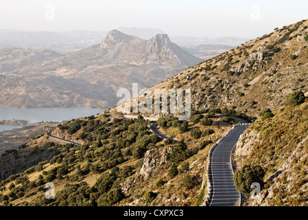 Evening sunlight on mountain road in Sierra de Grazalema, Andalusia, Spain - Stock Photo
