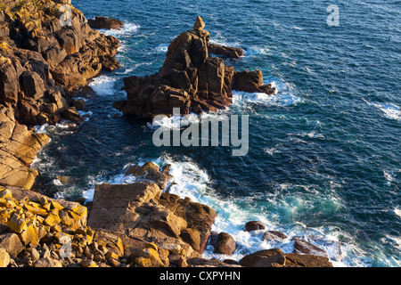 The small rocky island known as the Irish lady, taken from Pedn-men-du looking towards Gamper bay in Cornwall England. - Stock Photo